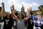 People cheer during a religious rally for Freddie Gray in front of the City Hall in Baltimore