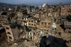 Nepal military personnel and earthquake survivors search for belongings in collapsed houses in Sankhu, on the outskirts of Kathmandu