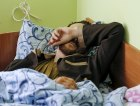 """A man, according to Ukraine's state security service (SBU) one of two Russian servicemen recently detained by Ukrainian forces, lies on a bed at a hospital in Kiev, Ukraine, May 19, 2015. Ukraine on Monday showed two prisoners it said were Russian soldiers who had killed Ukrainian troops in fighting in its east and said they would be prosecuted for """"terrorist acts"""". The Ukrainians seized on the capture of the two Russians, both wounded, to support their accusations of direct Russian involvement in the separatist conflict despite a ceasefire signed in February.  REUTERS/Gleb Garanich"""